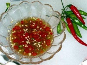 vietnamese style fish sauce with red chili pepper raw to dip steamed pork beef shrimp